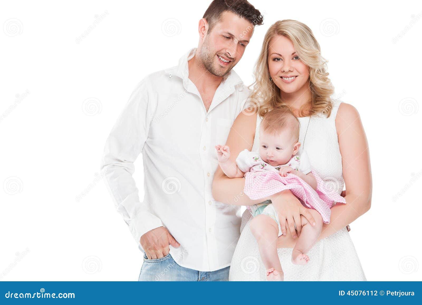 sch ne junge familie mit kleinem baby stockfoto bild von. Black Bedroom Furniture Sets. Home Design Ideas