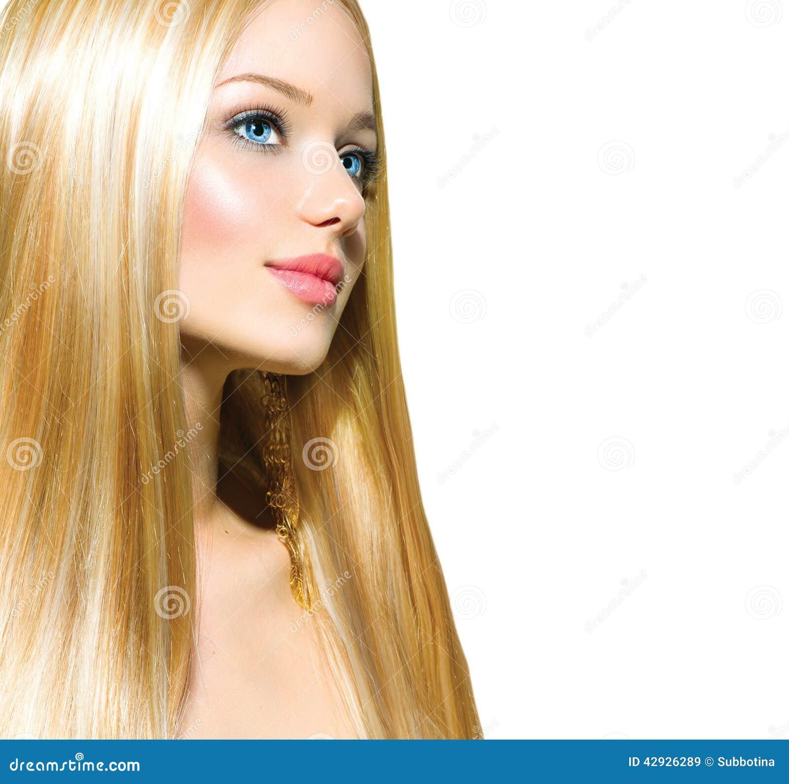 Schönes blondes Mädchen über Weiß