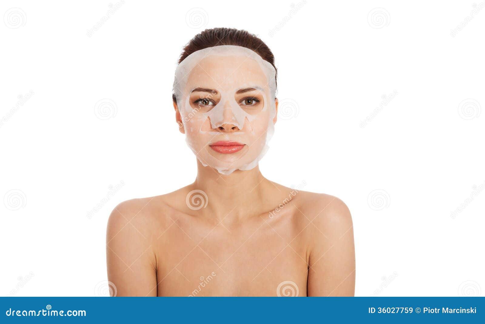 Lizenzfreie stockbilder schönheit mit kollagenmaske auf gesicht