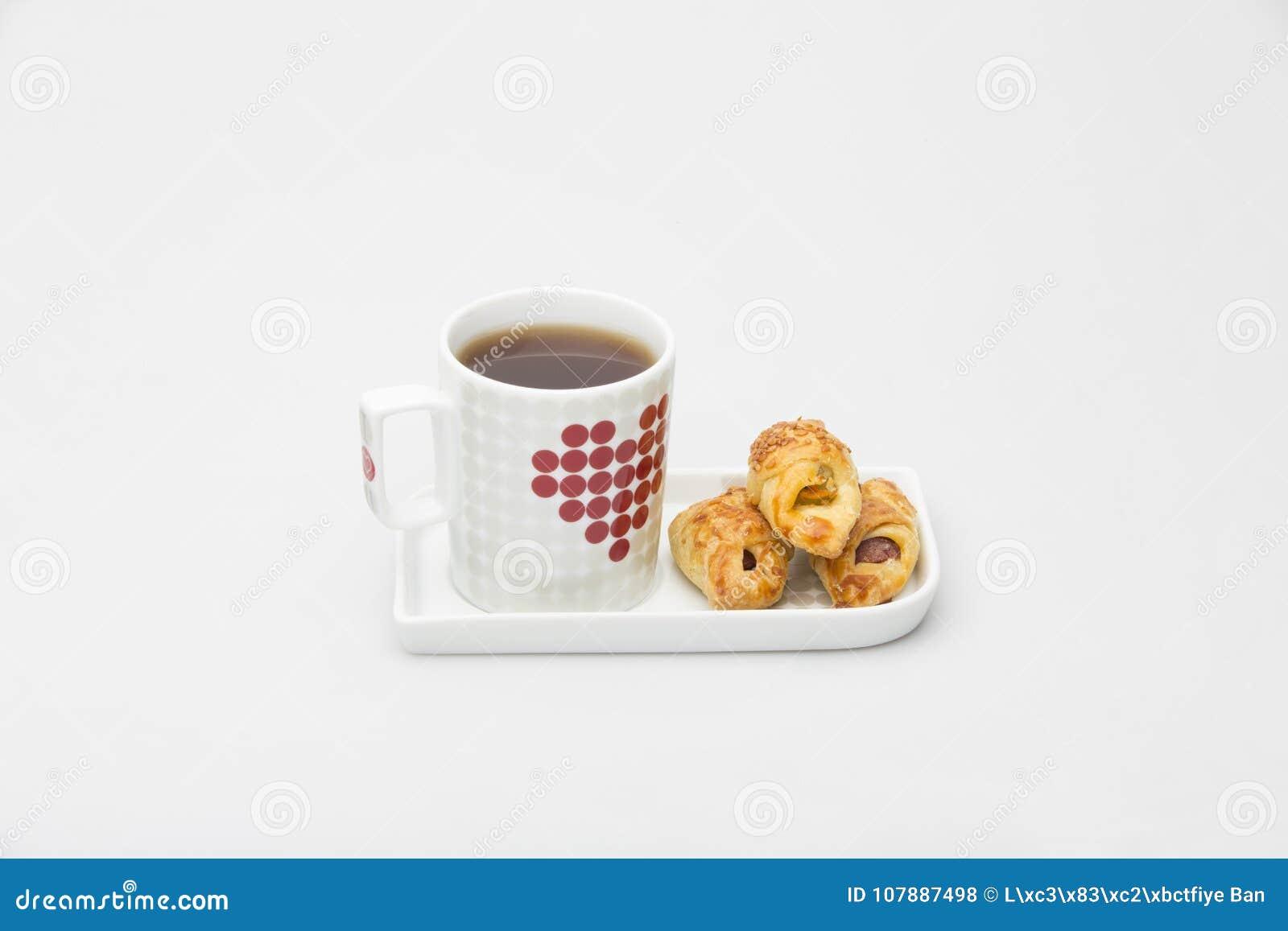 Schalen-Tee-Schwarz-weißes Rot und Plätzchen
