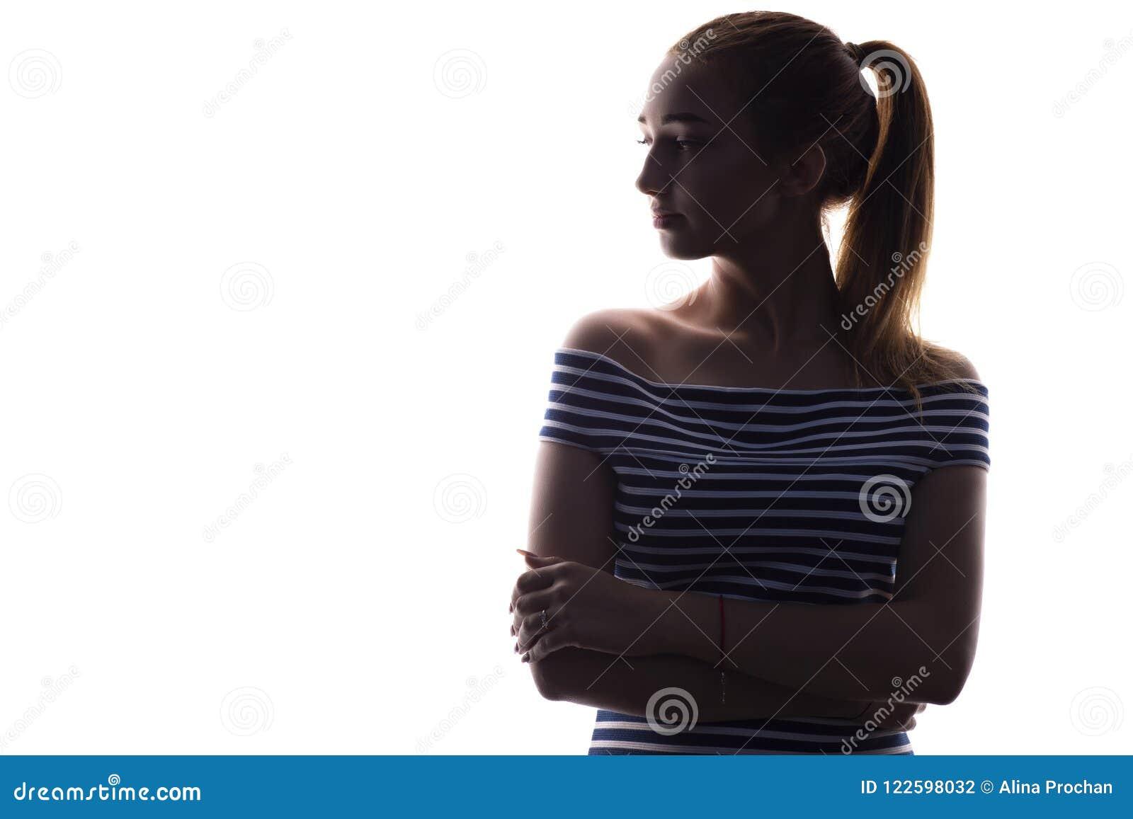 Schattenbild des Jugendlichmädchens auf einem Weiß lokalisierte Hintergrund, Frauengesichtsprofil