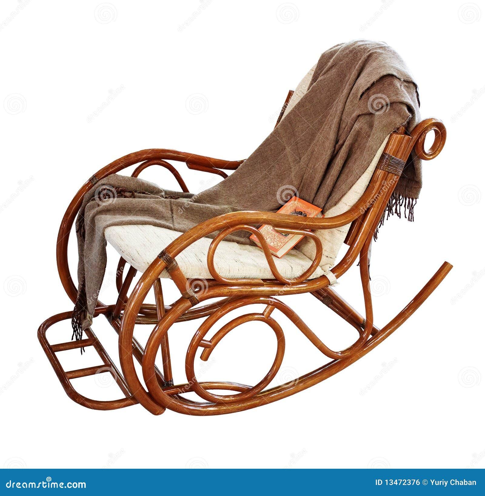 Schaukeln-Stuhl mit Wolldecke und Buch