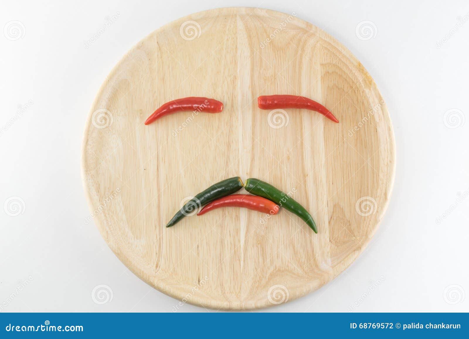 Schik de peper op een houten plaat