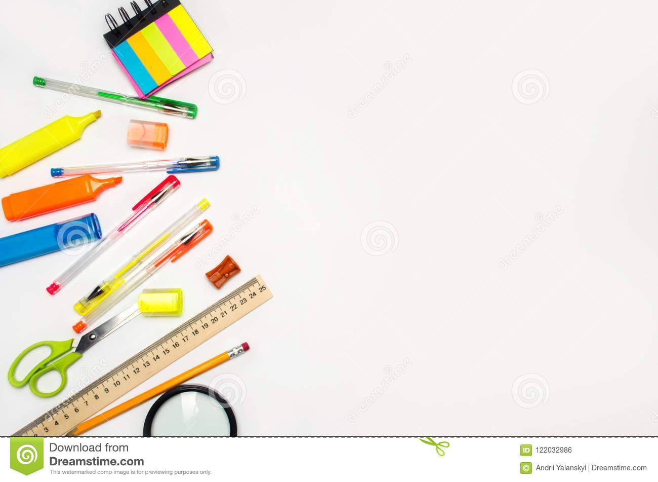 School accessories on a white background. stationery. back to school. concept of education. desk. color pens, pencils, ruler, alar