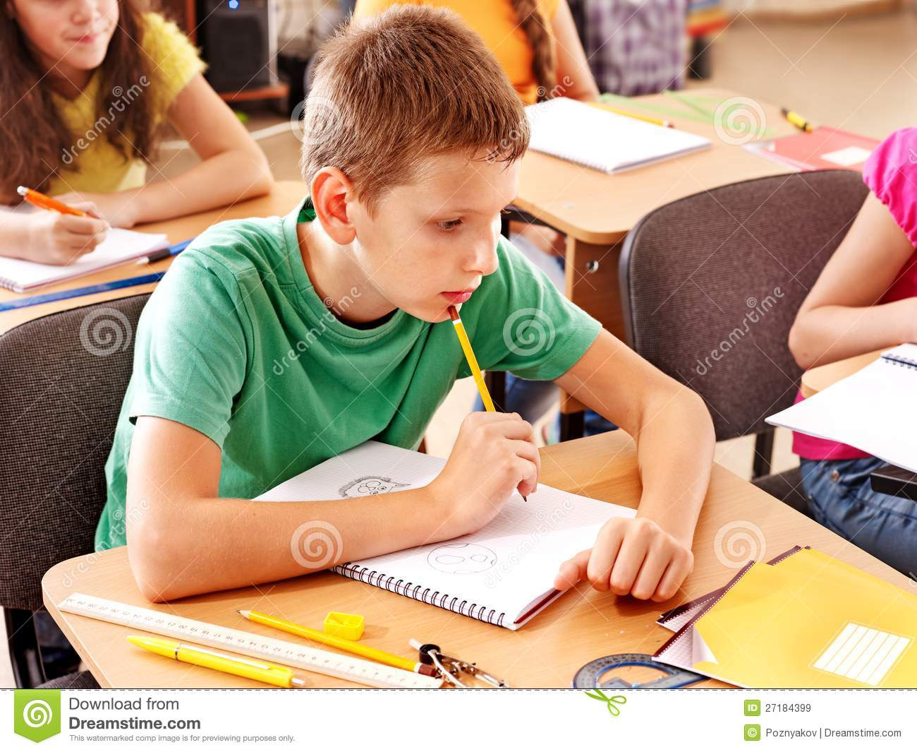 School Child Sitting In Classroom Royalty Free Stock
