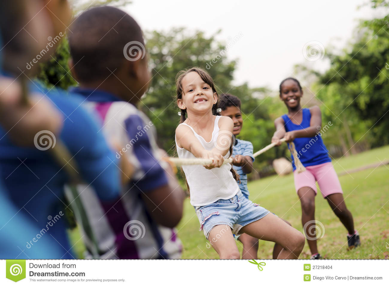 School children playing tug of war with rope