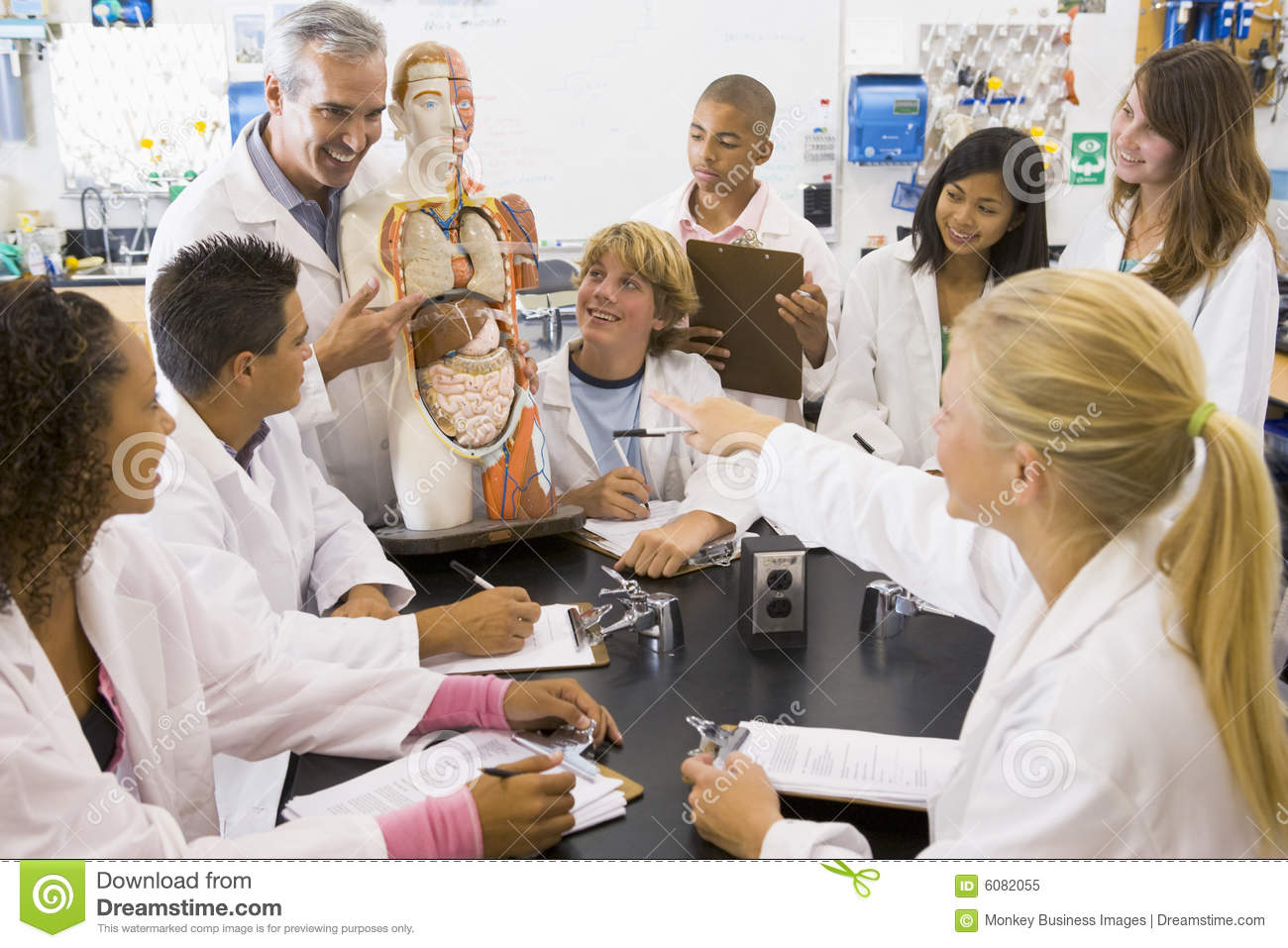 School Children And Their Teacher In Science Class Stock