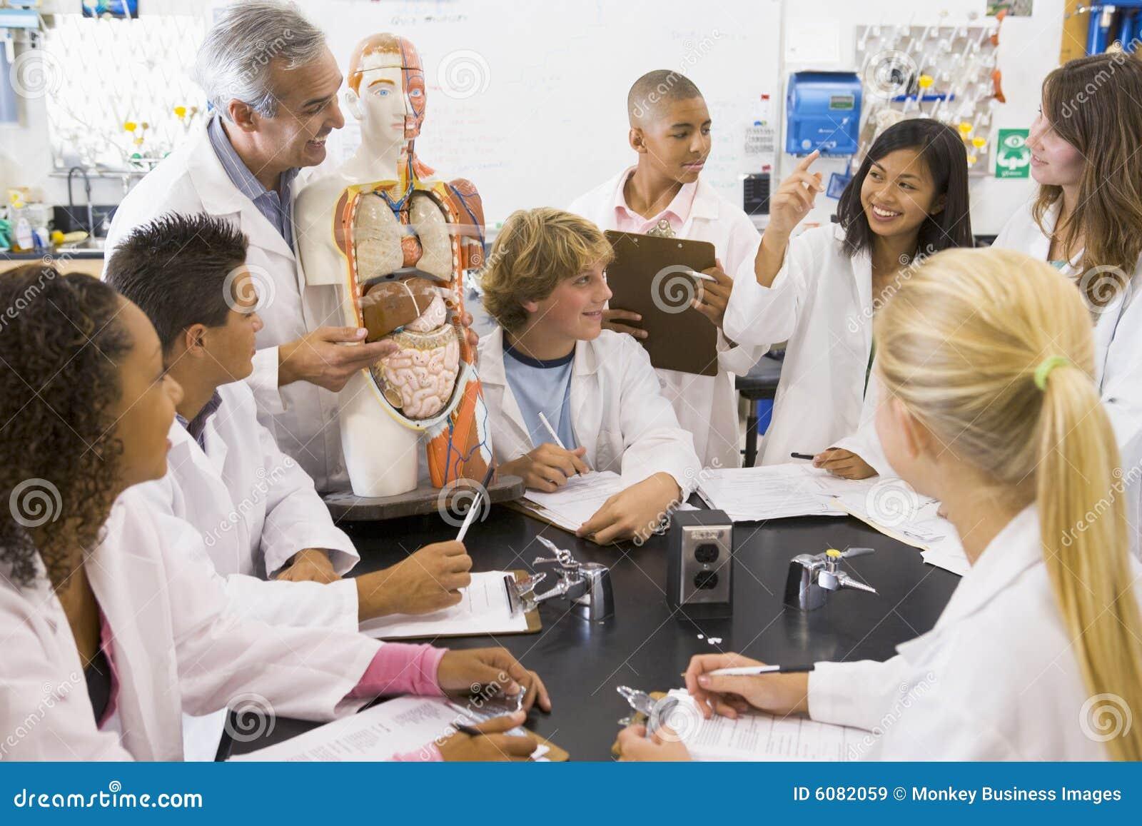 School Children And Their Teacher In Science Class Stock