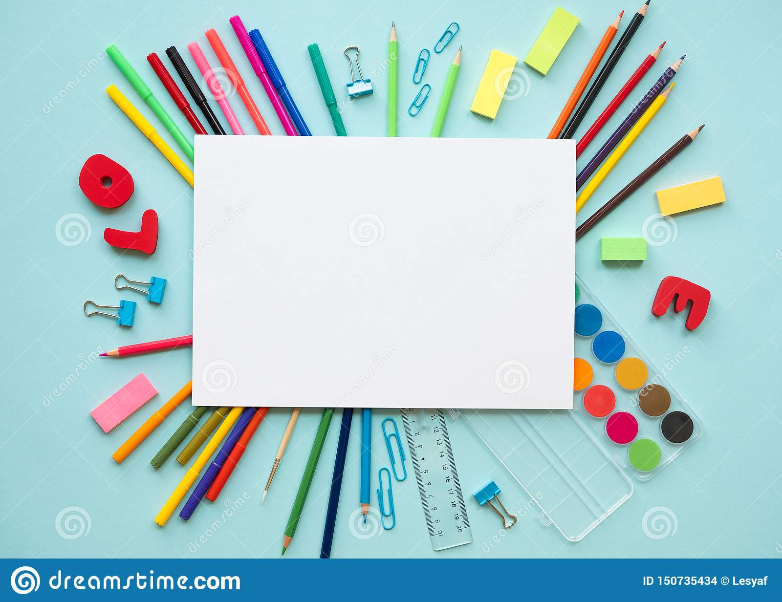 School elements on blue background with space for text symbolizing back to school.