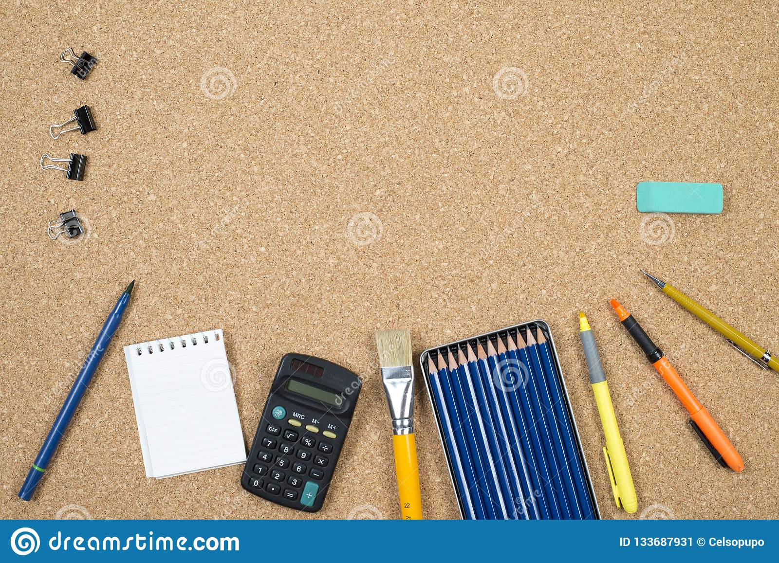 School elements on cork background with space for text symbolizing back to school