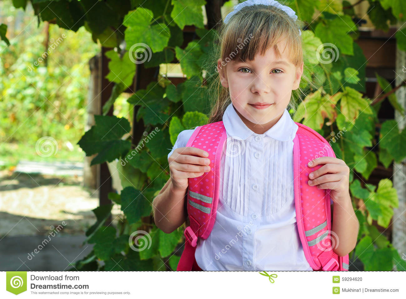 Elementary Age Schoolgirl In Uniform With Backpack Royalty