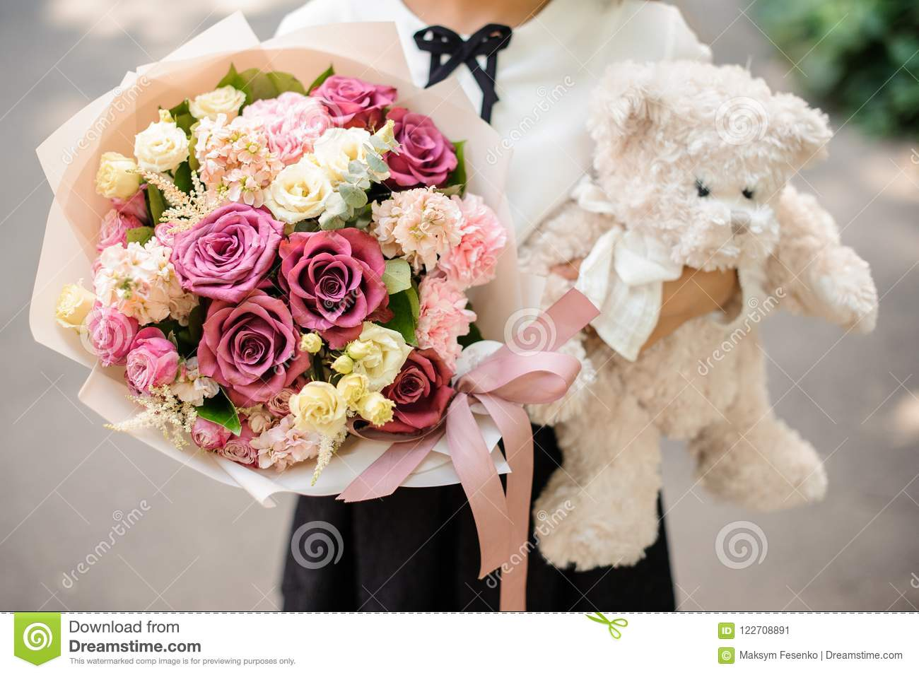 Download School Girl Dressed In School Uniform Holding A Bright Colorful  Festive Bouquet And Teddy Bear