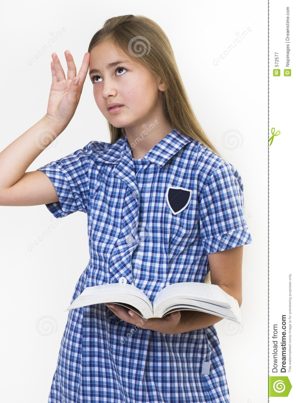 image Teen reading a book posing her feet