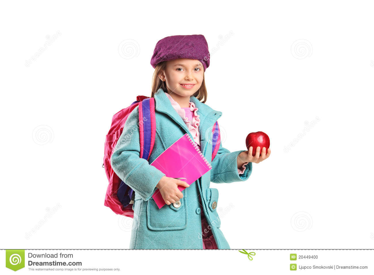 7a11297a7a3a A school girl with backpack holding notebook and red apple isolated on white  background