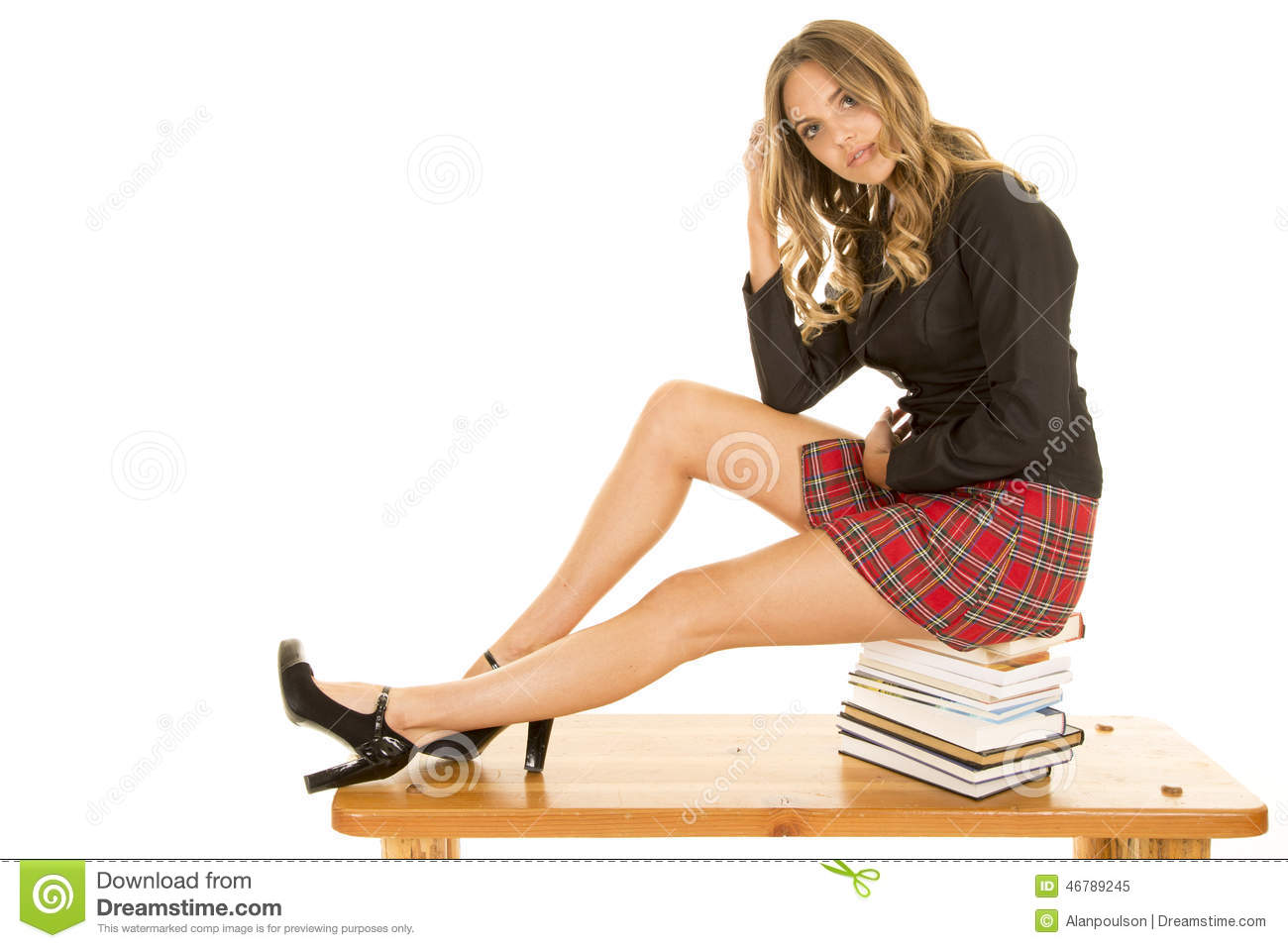 school girl sit on books legs out stock photo image 46789245. Black Bedroom Furniture Sets. Home Design Ideas