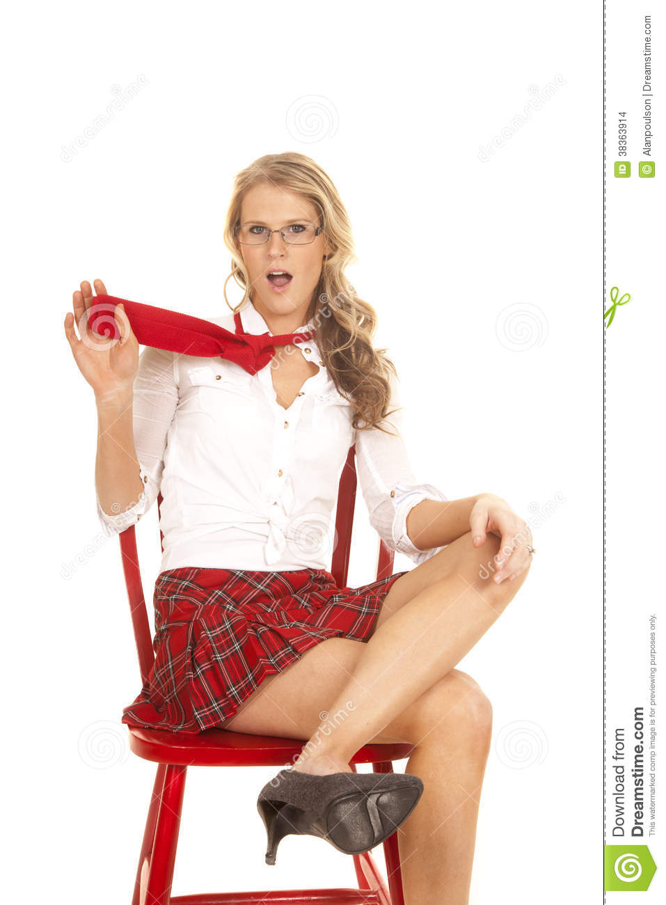 Excellent Young Woman In Skirt And Is Sitting On The Chair Stock Image  Image