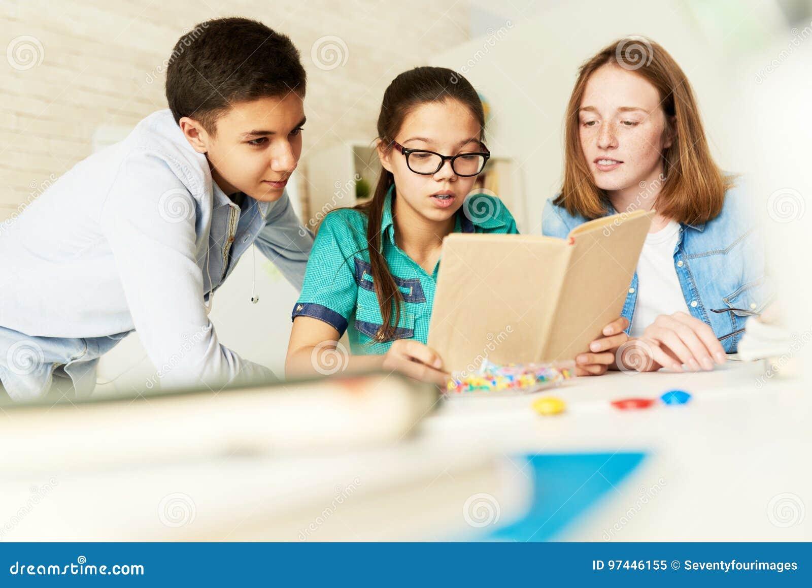 School Kids Reading Book Together