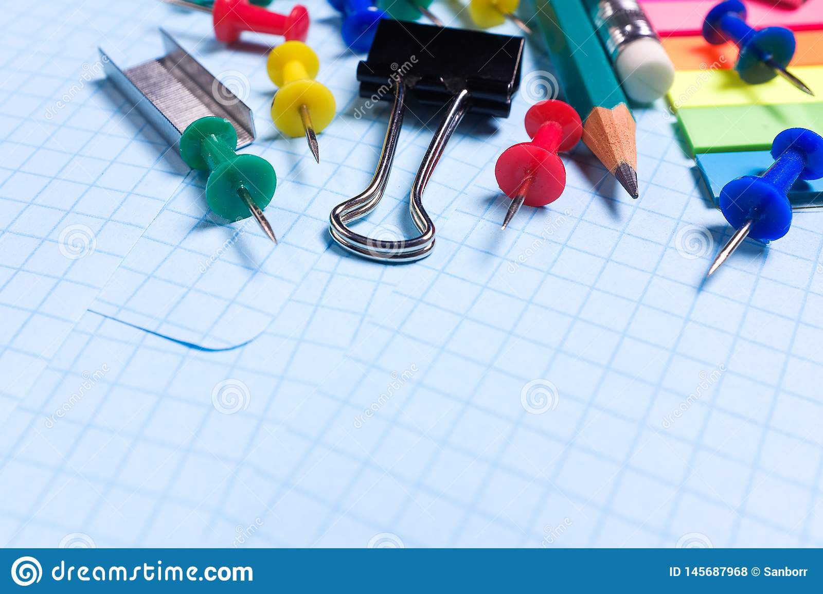 School and office stationery on a white sheet. The concept of education, office work, business, entrepreneurship. Workplace