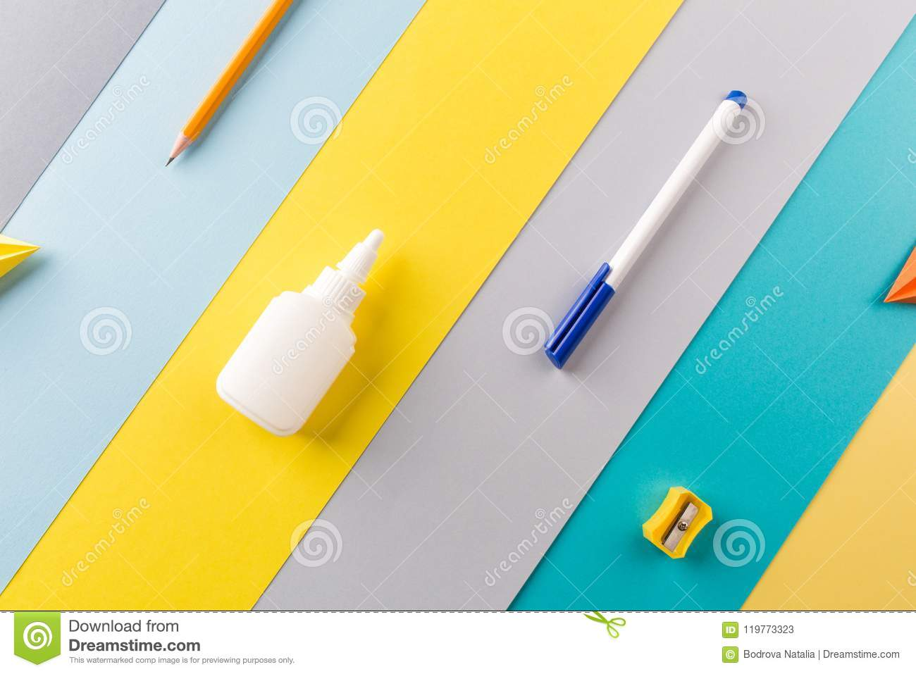 School and office supplies on bright striped background. concept: back to school, minimalism.