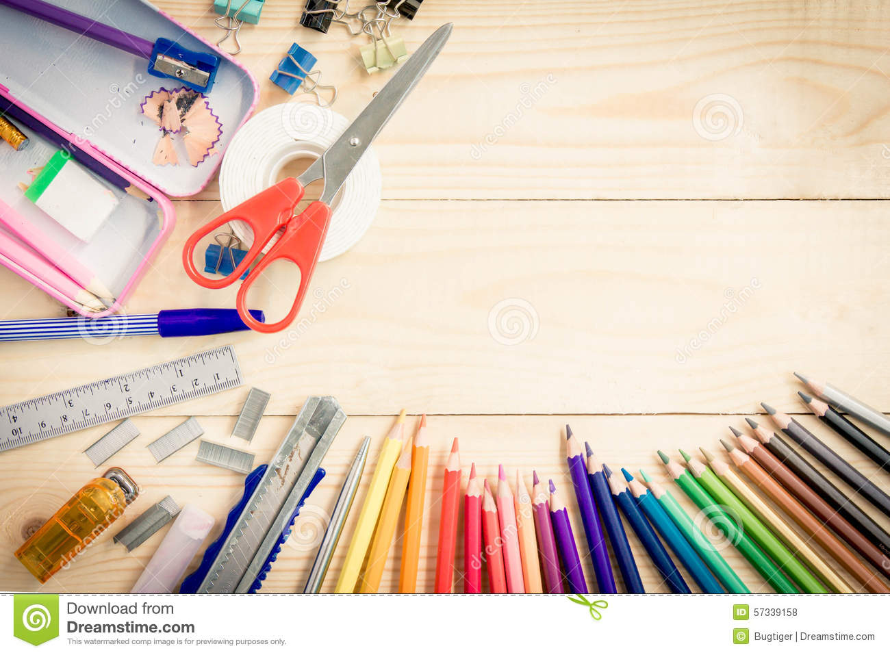school and office supplies on wood background  back to
