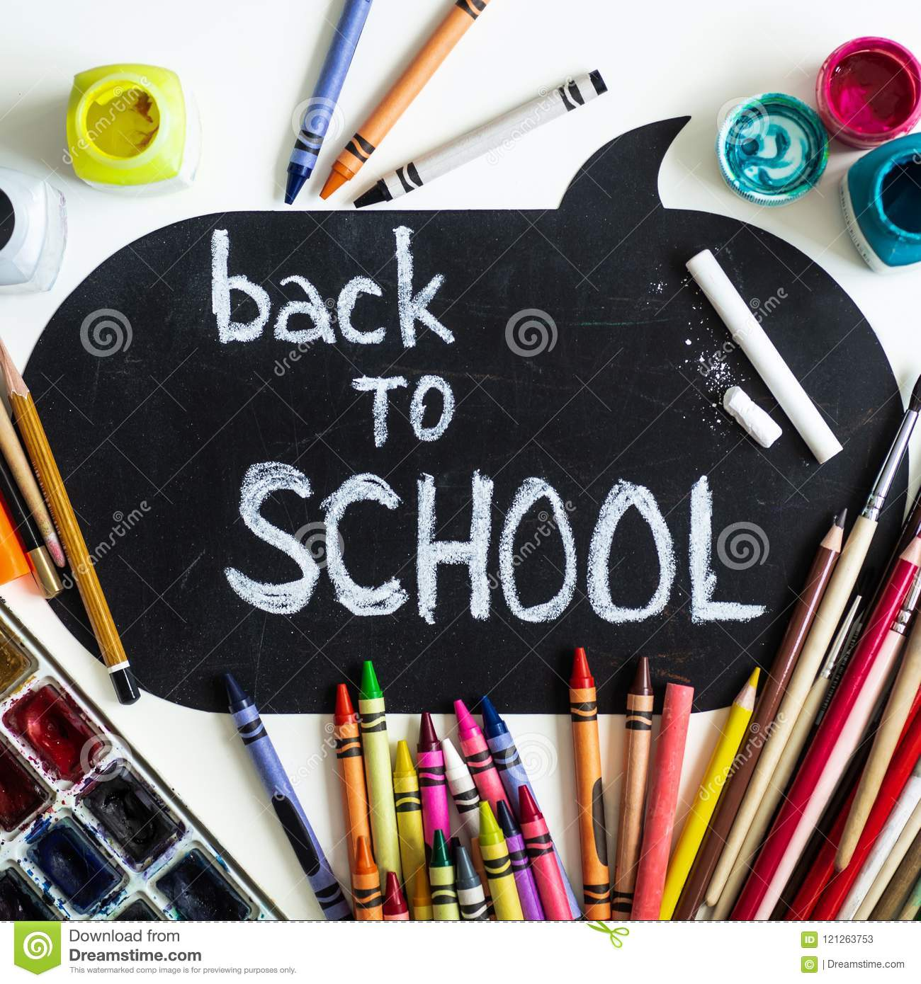 Back to School chalkboard tag with school supplies on blackboard background. Ready for your design. Back to school concept