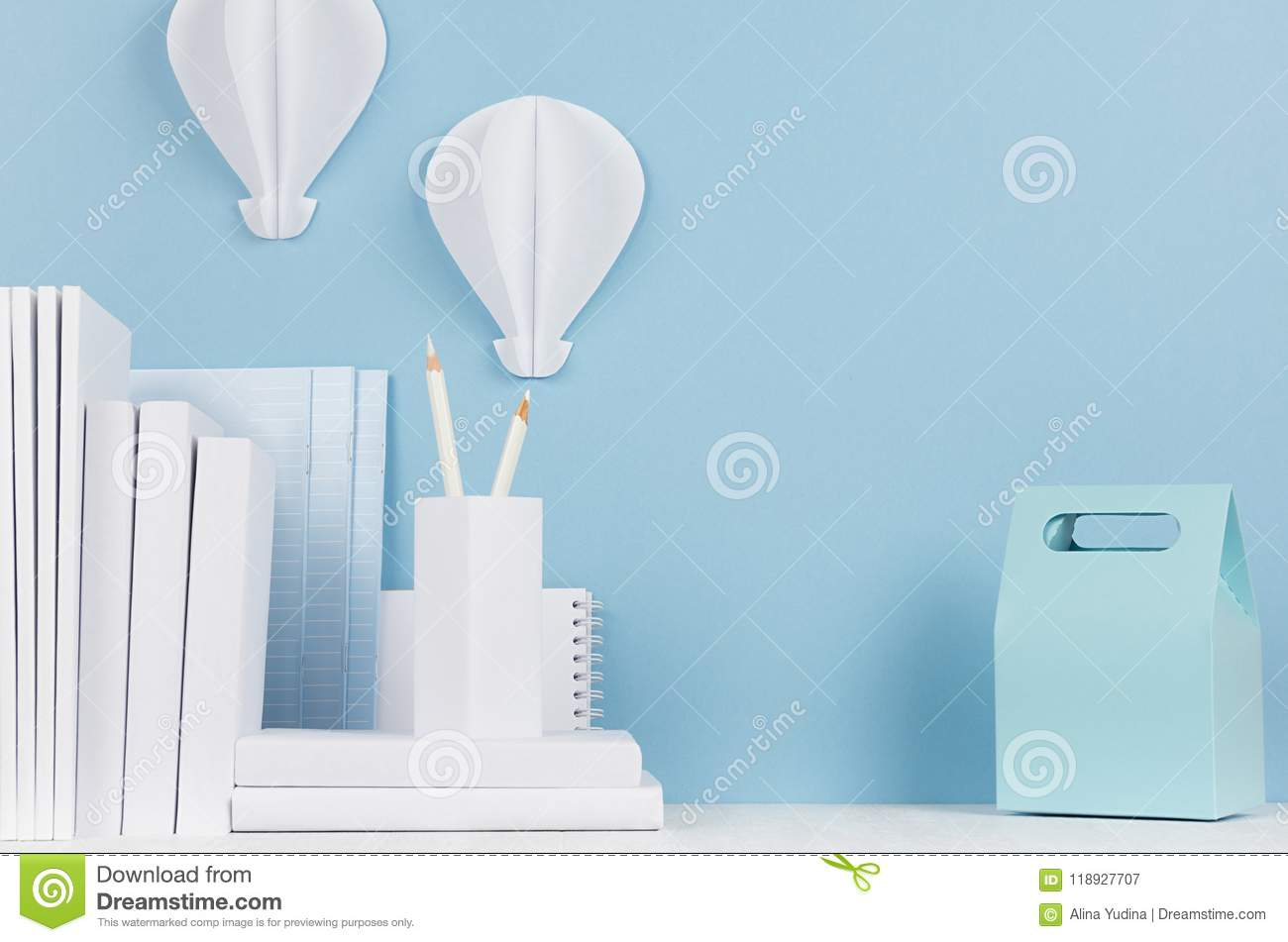School template - white stationery and lunch box on white desk and soft blue background. Back to school background with copy spac