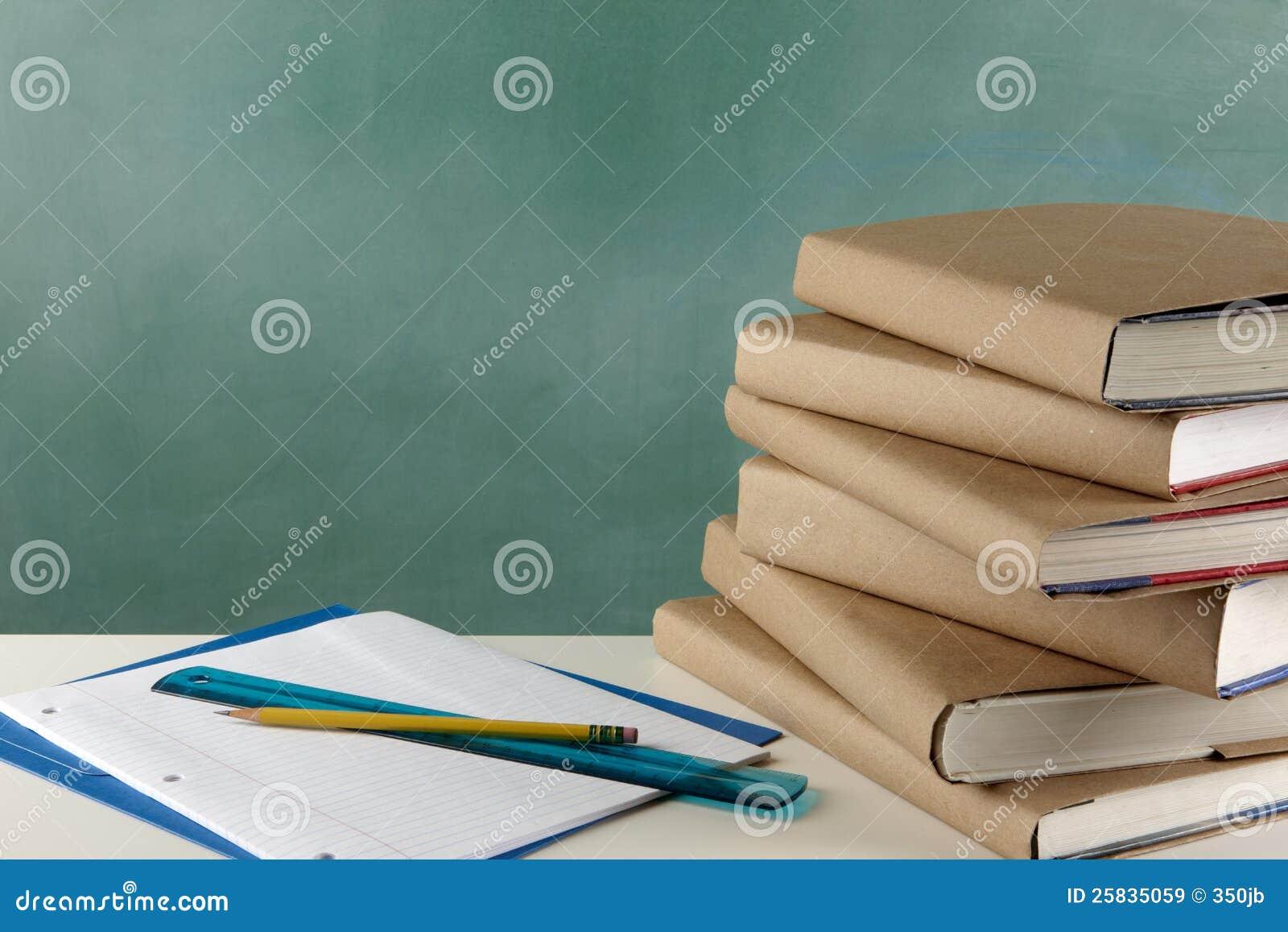 Schoolbooks, loose leaf paper, ruler and pencil