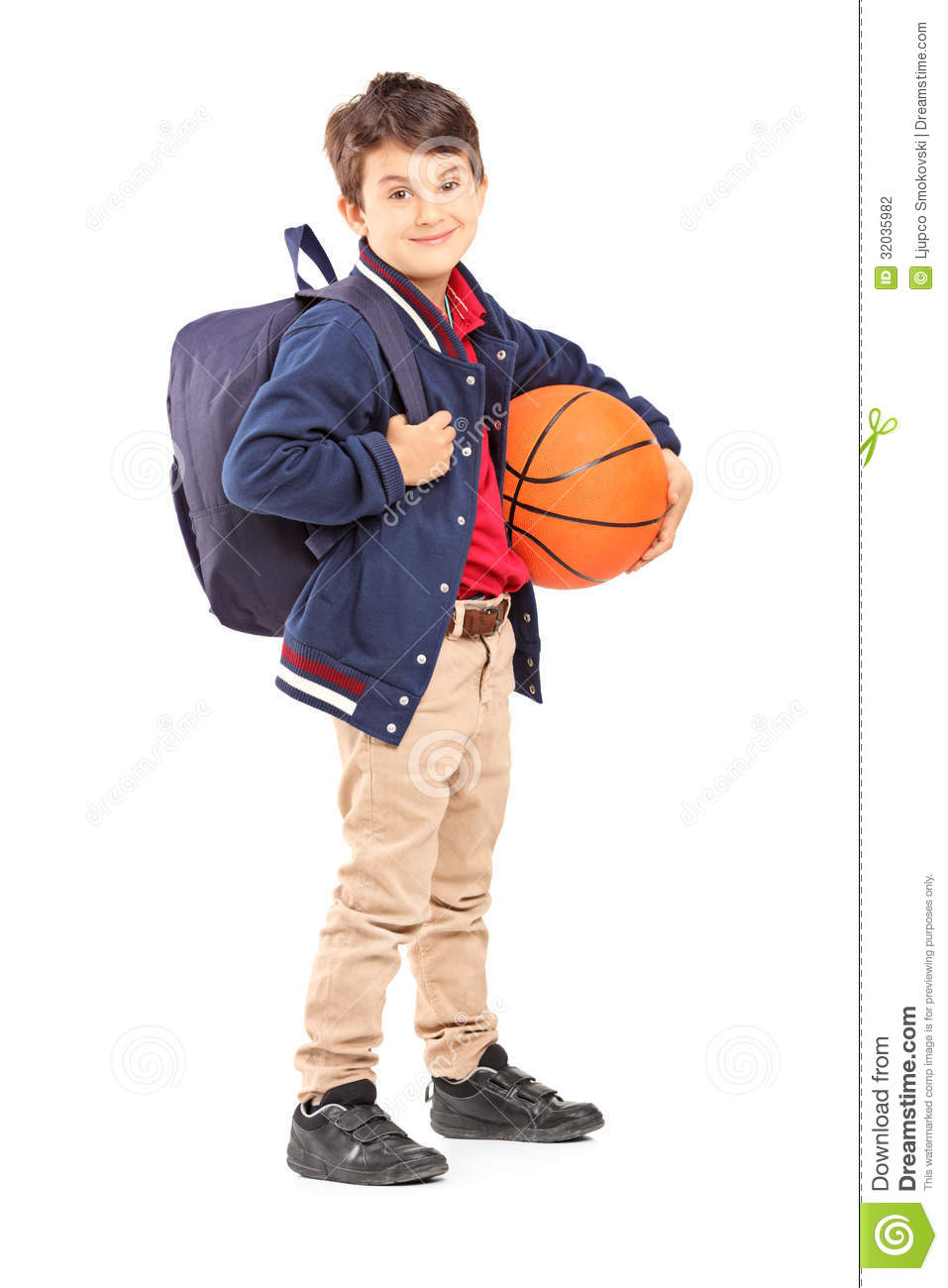 Schoolboy With Backpack Holding A Basketball Stock Photo ...