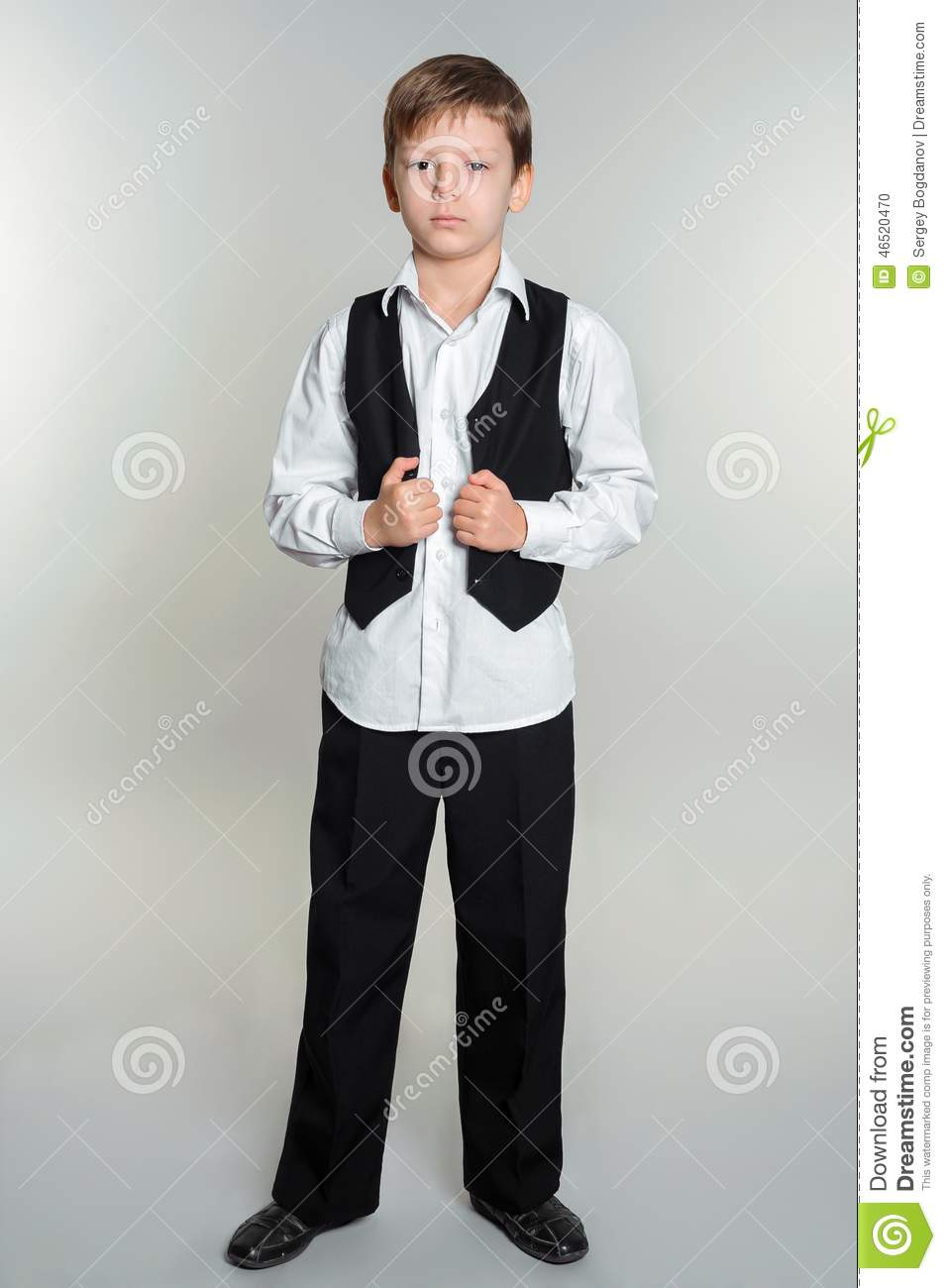 Full length portrait of boy in school uniform.