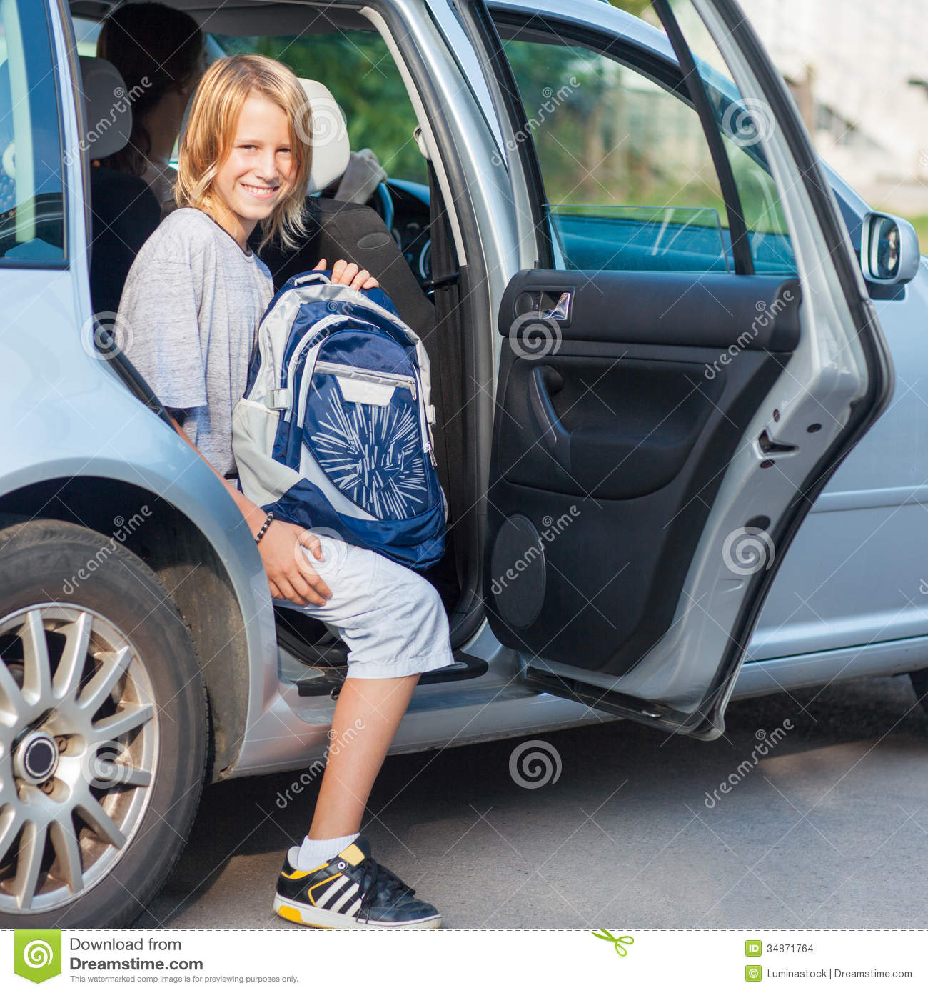 Schoolboy Getting Out Of The Car Stock Images Image