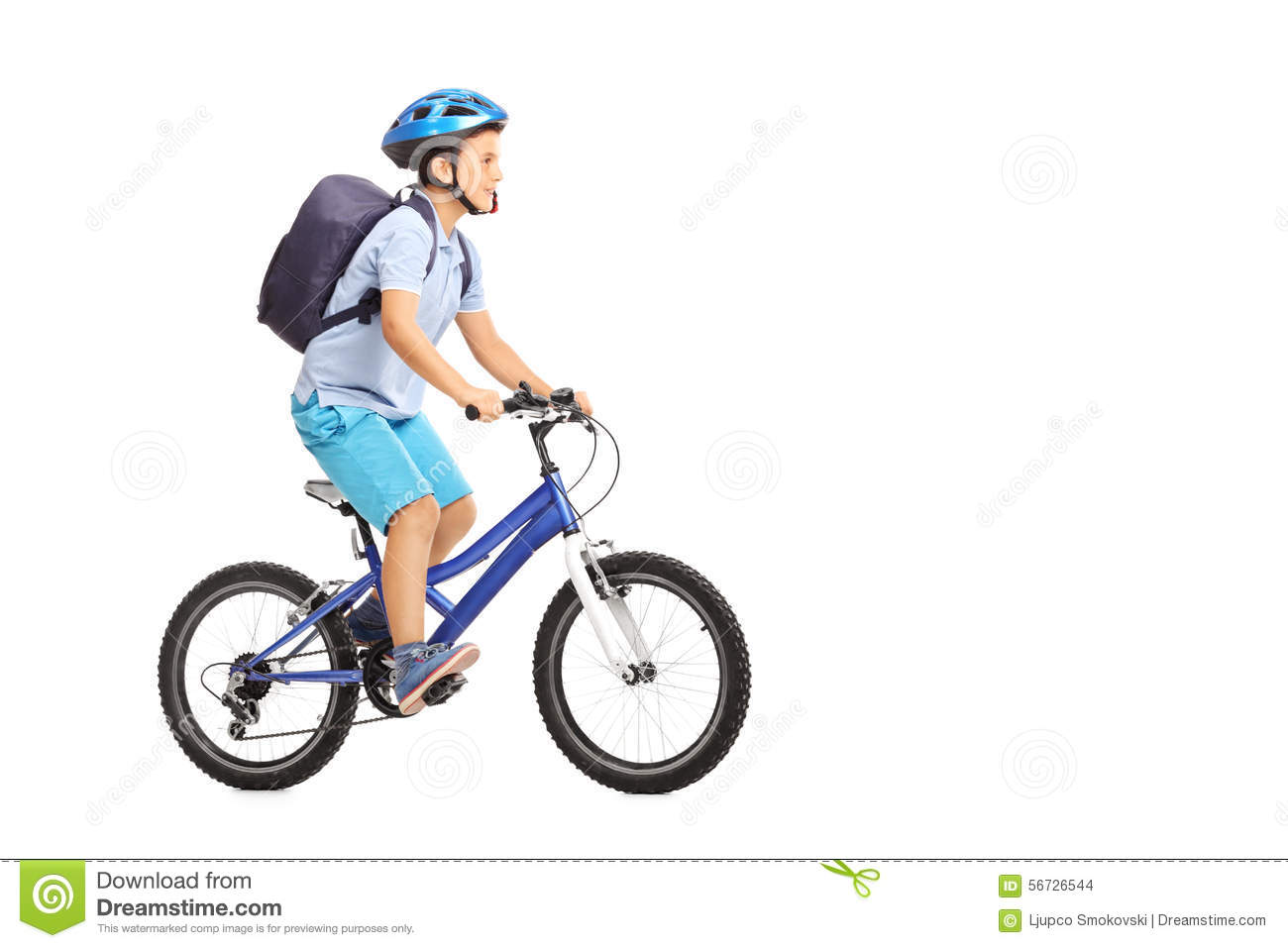schoolboy with a helmet riding a bike stock photo image of