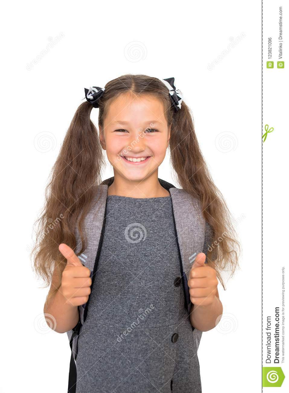 Schoolchild shows a thumb up.