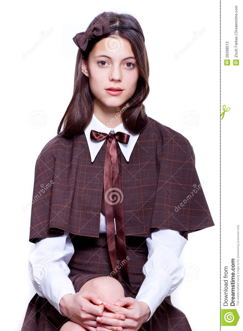 Teen school girl wearing old style formal clothes   isolated