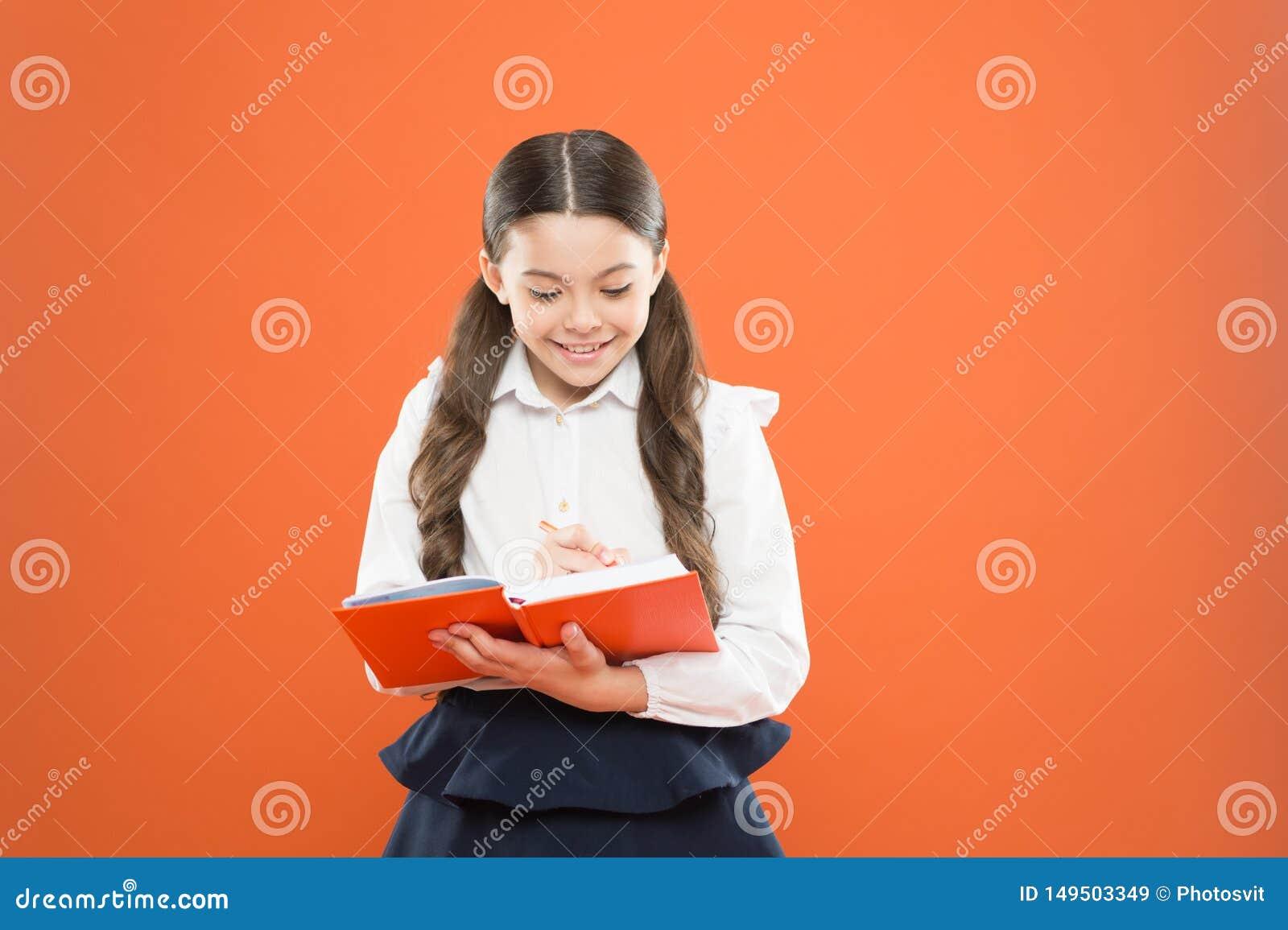 Schoolgirl enjoy study. Kid school uniform hold workbook. School lesson. Child doing homework. Your career path begins