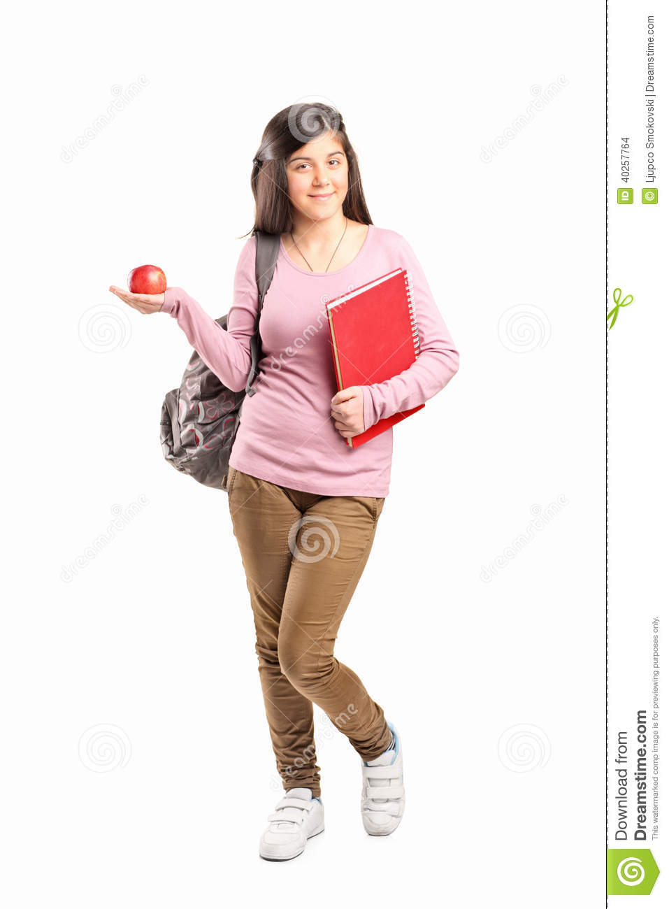 c4237098cc46 Schoolgirl Holding An Apple Stock Photo - Image of notebook ...