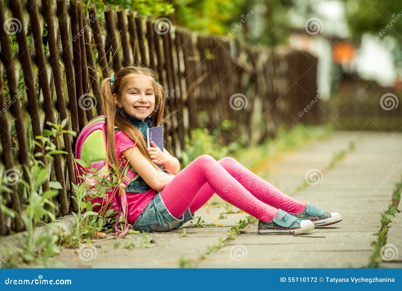 Schoolgirl Reading A Book On The Street Stock Photo ...