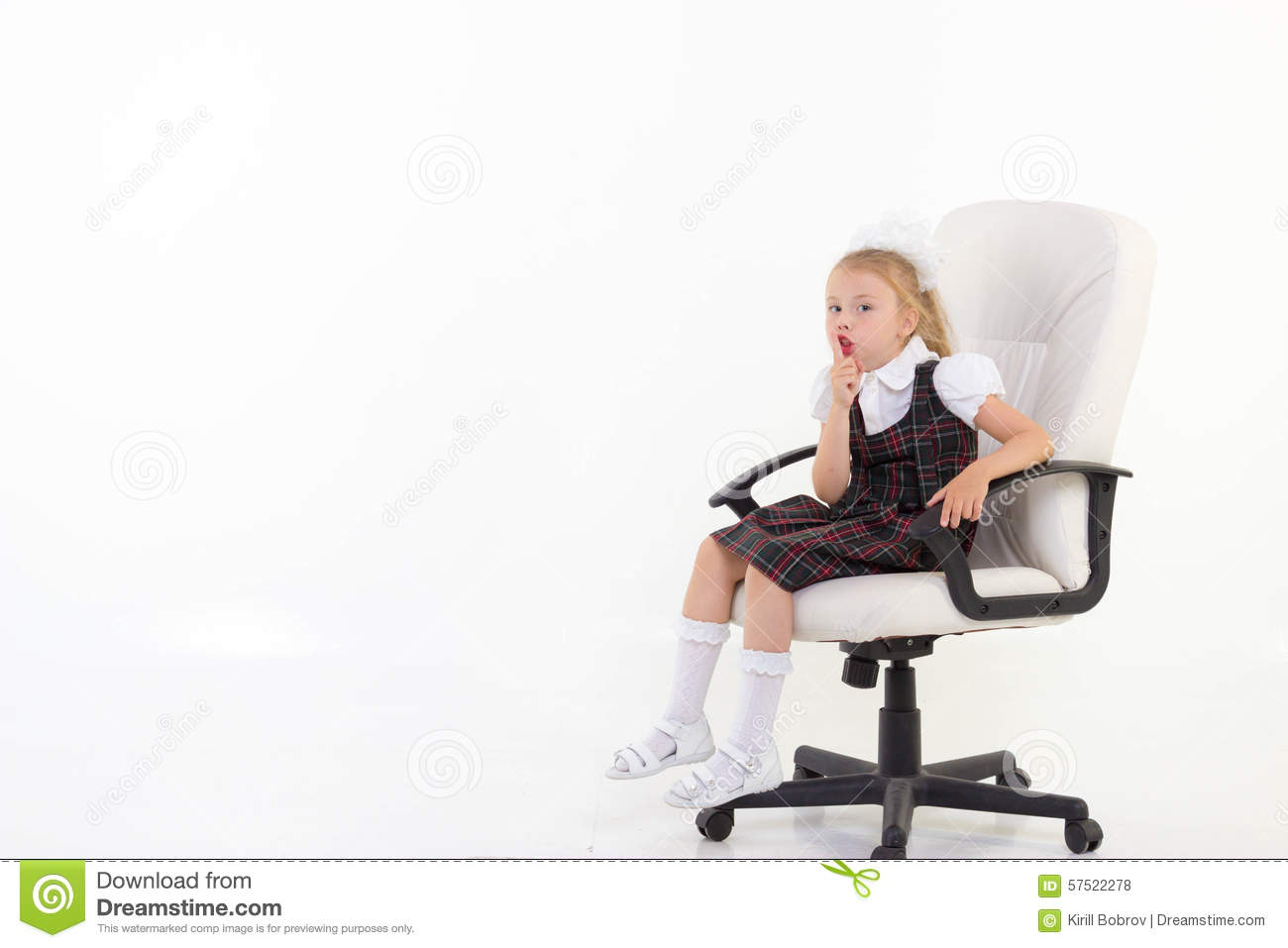 schoolgirl sit on chair and ask to be quiet stock photo. Black Bedroom Furniture Sets. Home Design Ideas