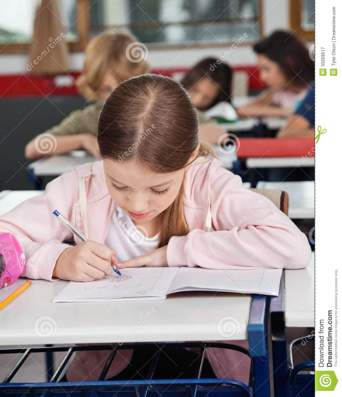 Writing Desk Background ~ Schoolgirl writing at desk royalty free stock photography