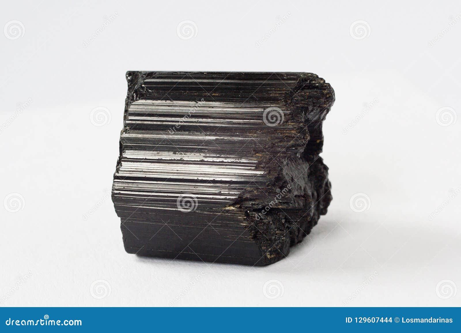Schorl mineral also black tourmaline on white background