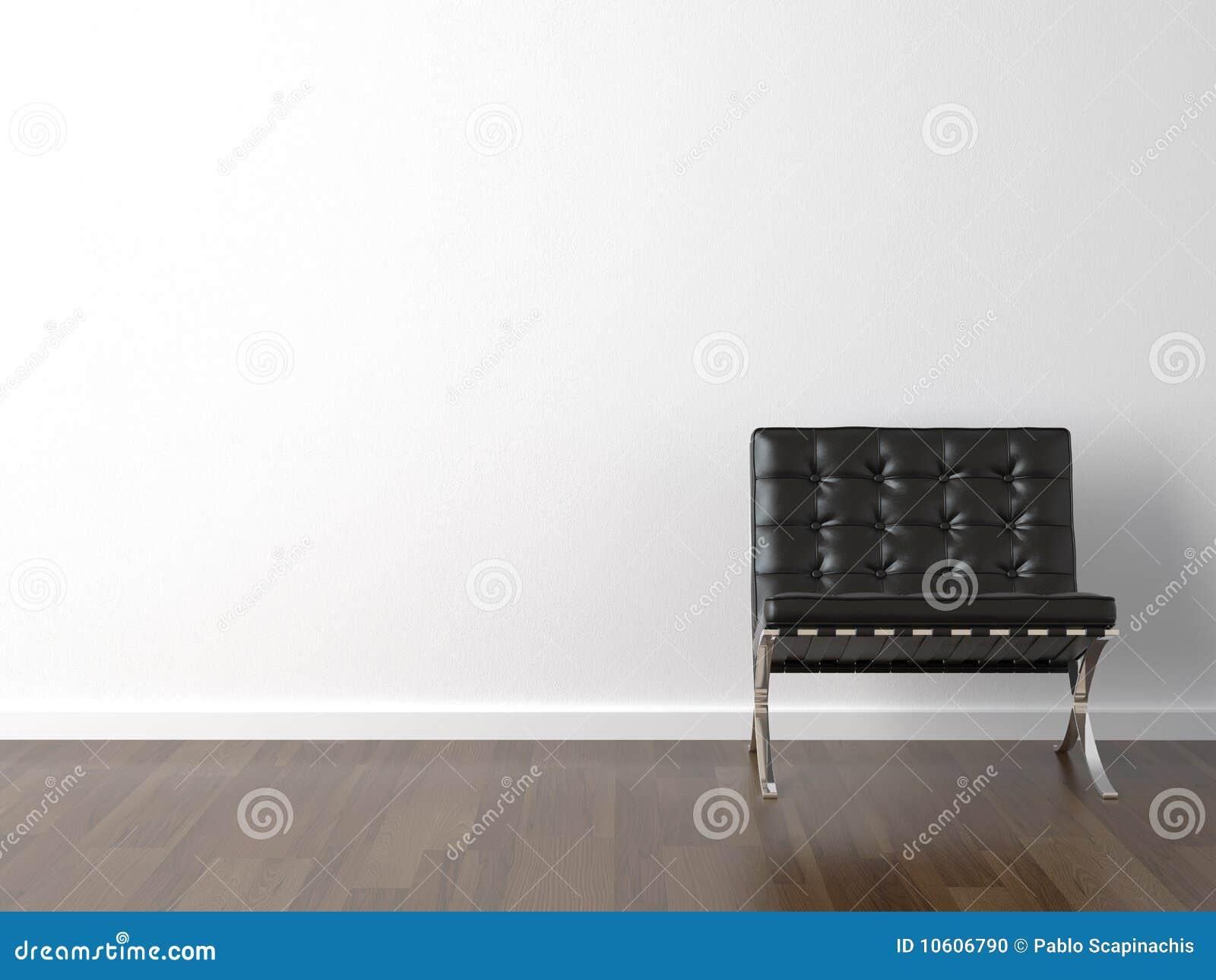 Schwärzen Sie Stuhl auf weißer Wand