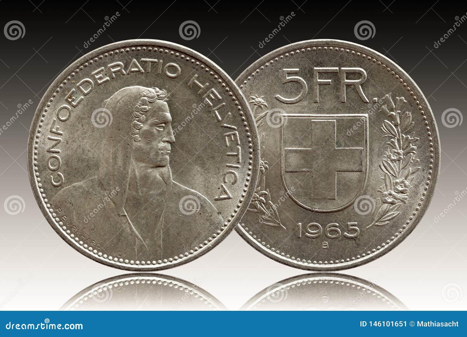 Schweizer Münze 5 der Schweiz fünf silberne des Franken 1965 lokalisiert auf Steigungshintergrund