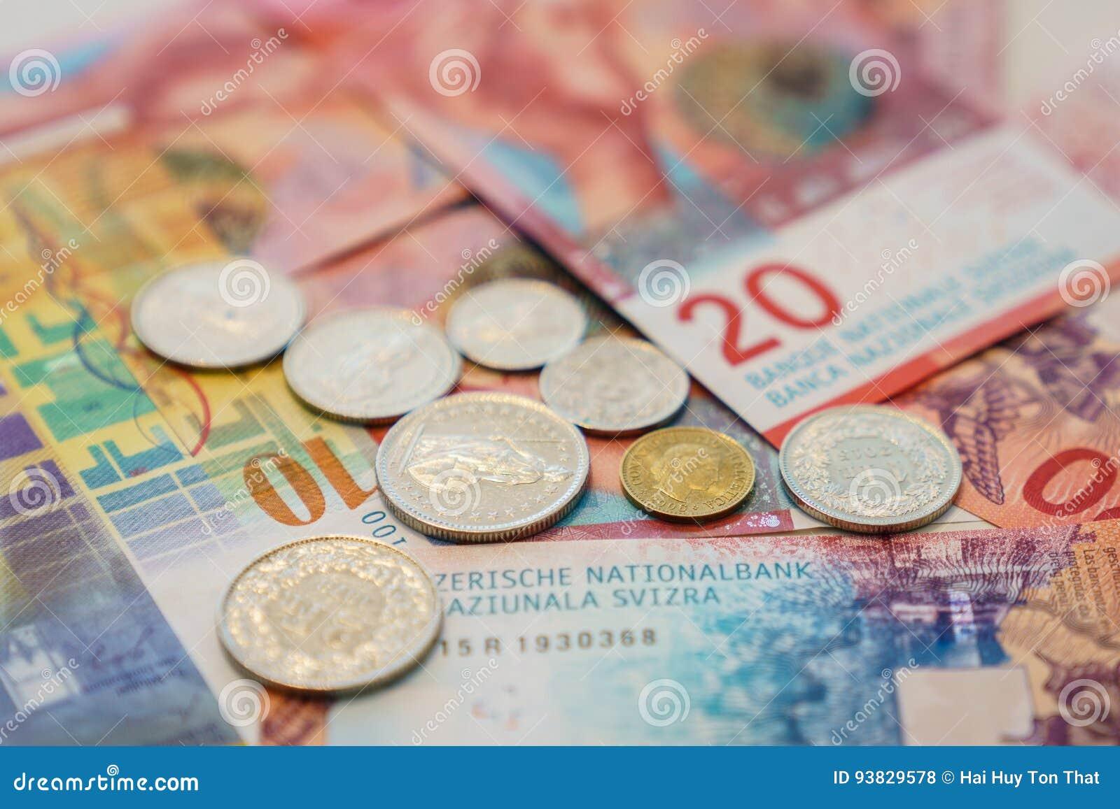 Schweizisk franc anmärkningar och mynt med nya tjugo schweizisk francräkningar