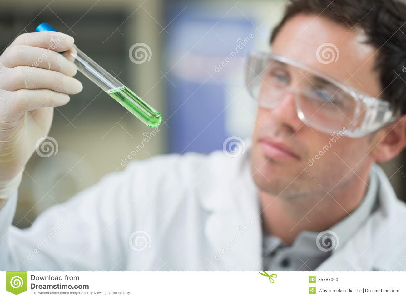 scientist analyzing green solution in test tube at laboratory stock photo image 35787060. Black Bedroom Furniture Sets. Home Design Ideas