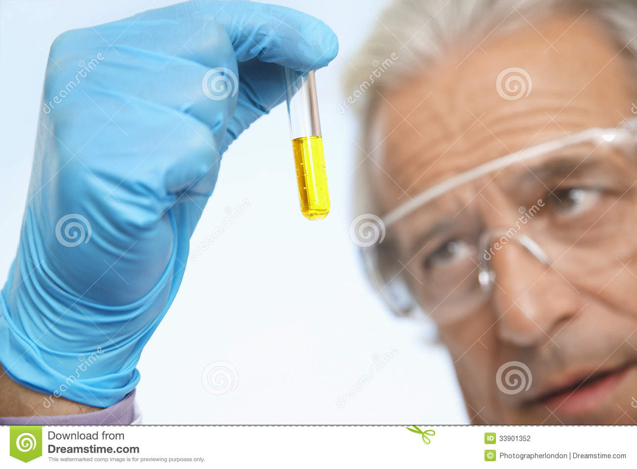 Scientist Examining Test Tube Of Yellow Liquid Stock Photography - Image 33901352-8121