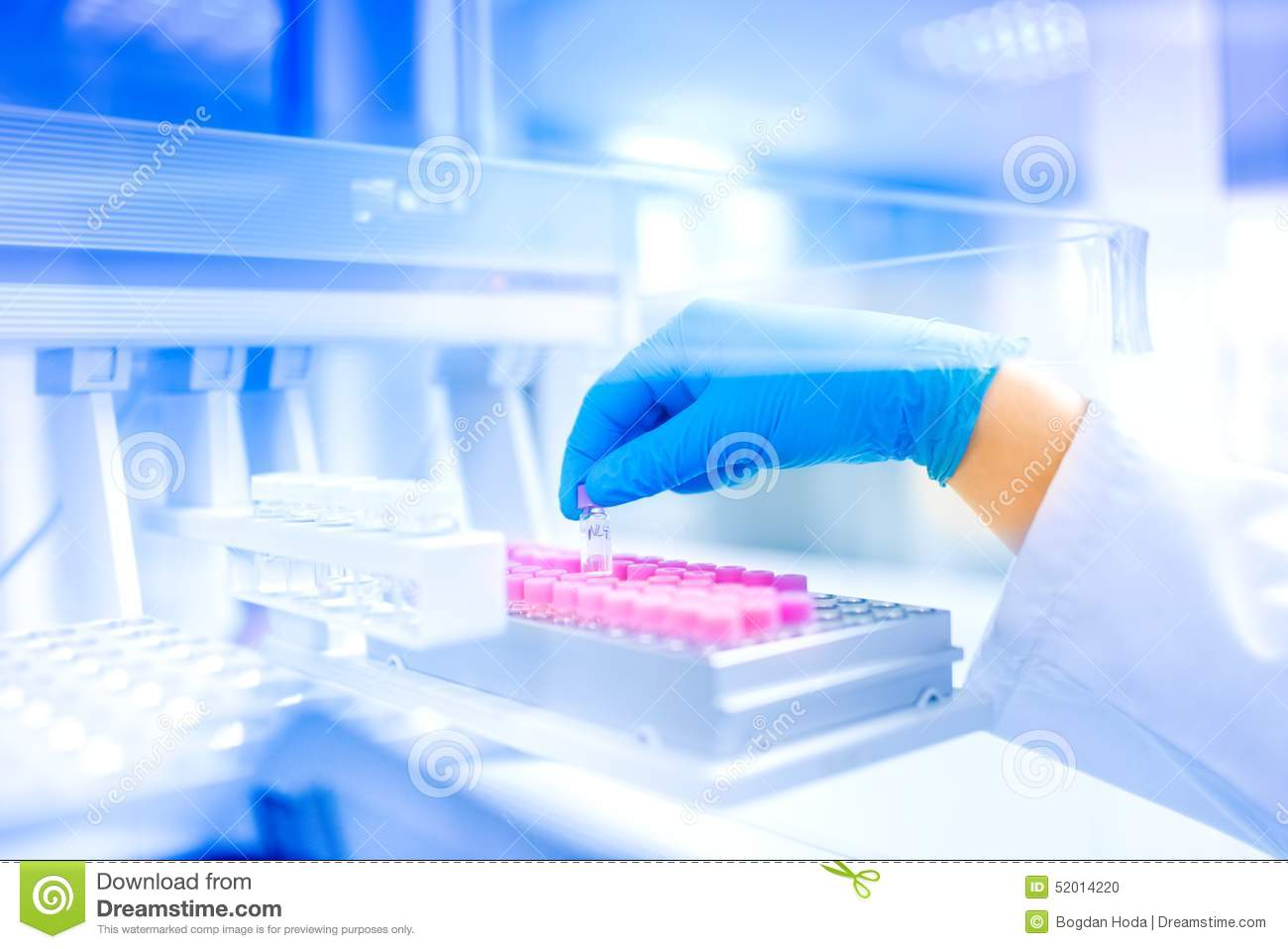 Scientist hand holding sample in special laboratory, medical environment, hospital details