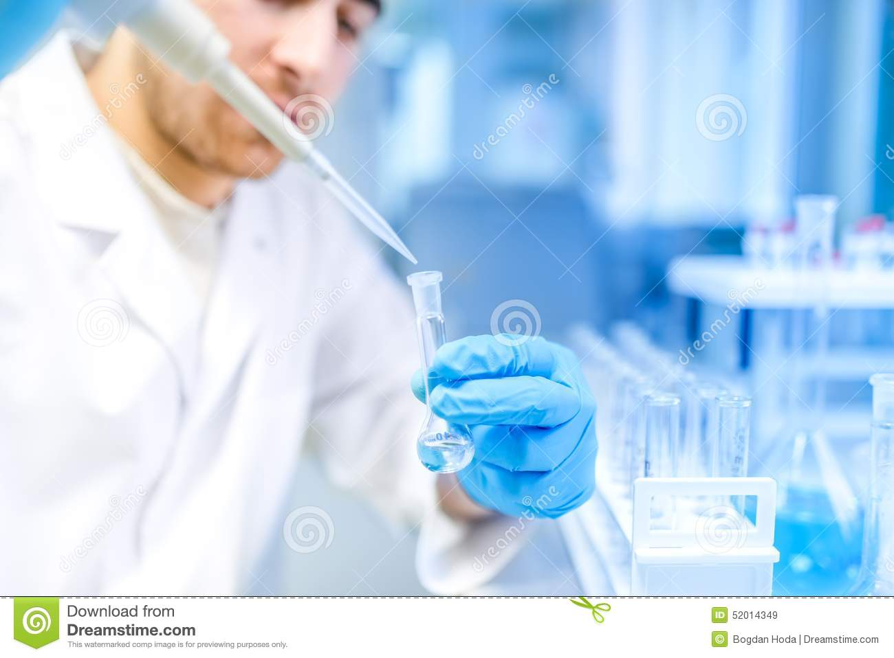 Scientist using medical tool for extraction of liquid from samples in special laboratory or medical room