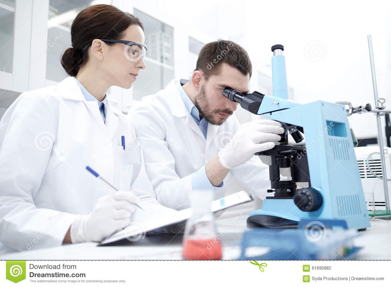 scientists microscope biology lab science research technology chemistry making test laboratory clipboard young concept doctors preview