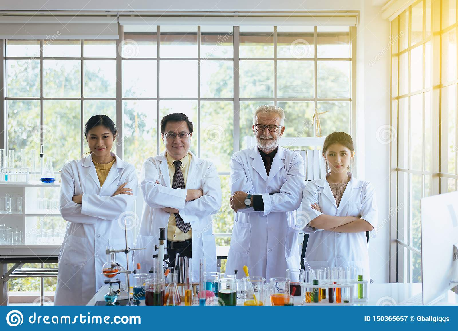 Scientists standing and cross arms,Group of diversity people teamwork in laboratory,Success and reserch working
