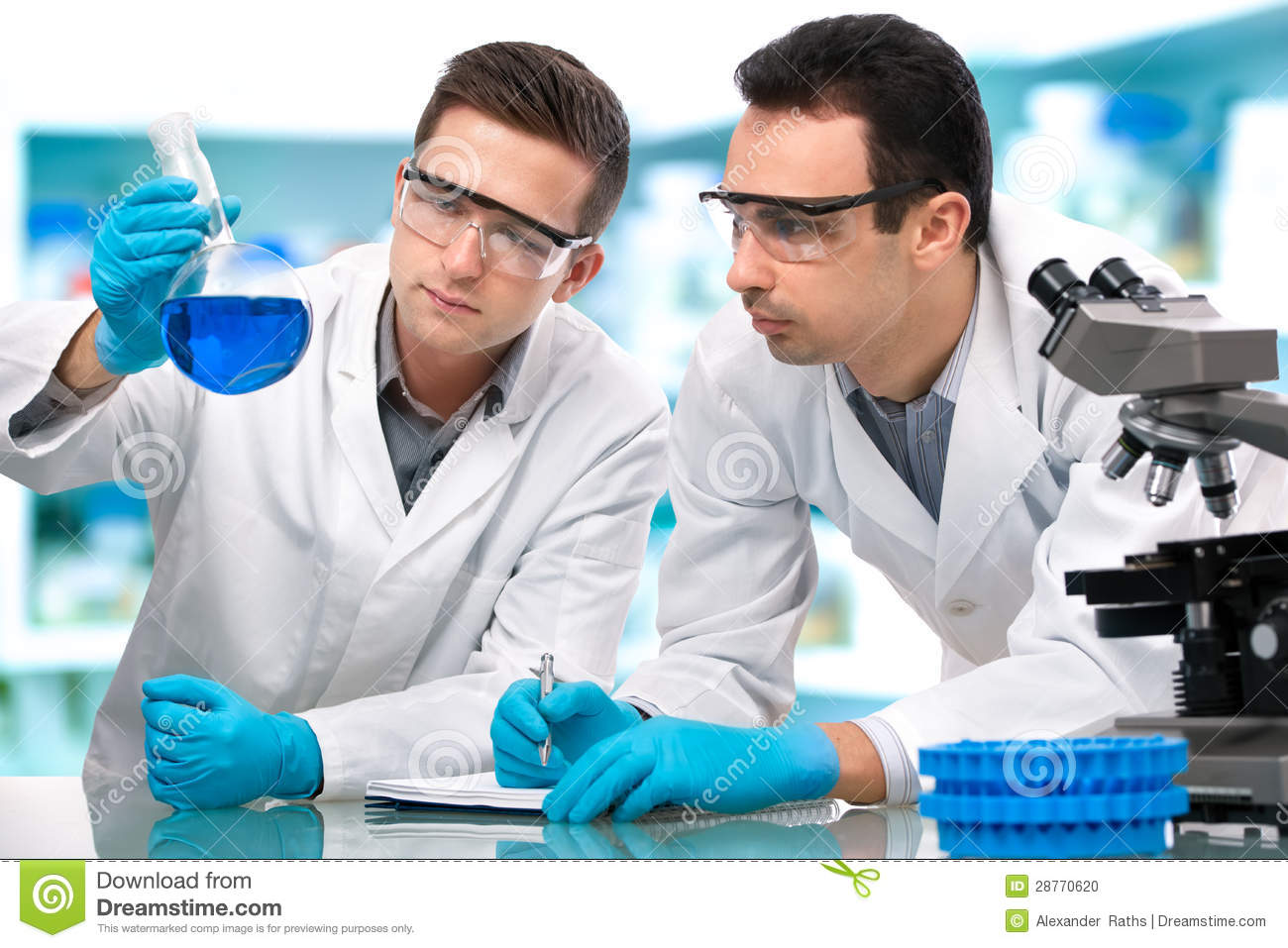 Scientists Working In A Research Laboratory Stock Photo - Image ...