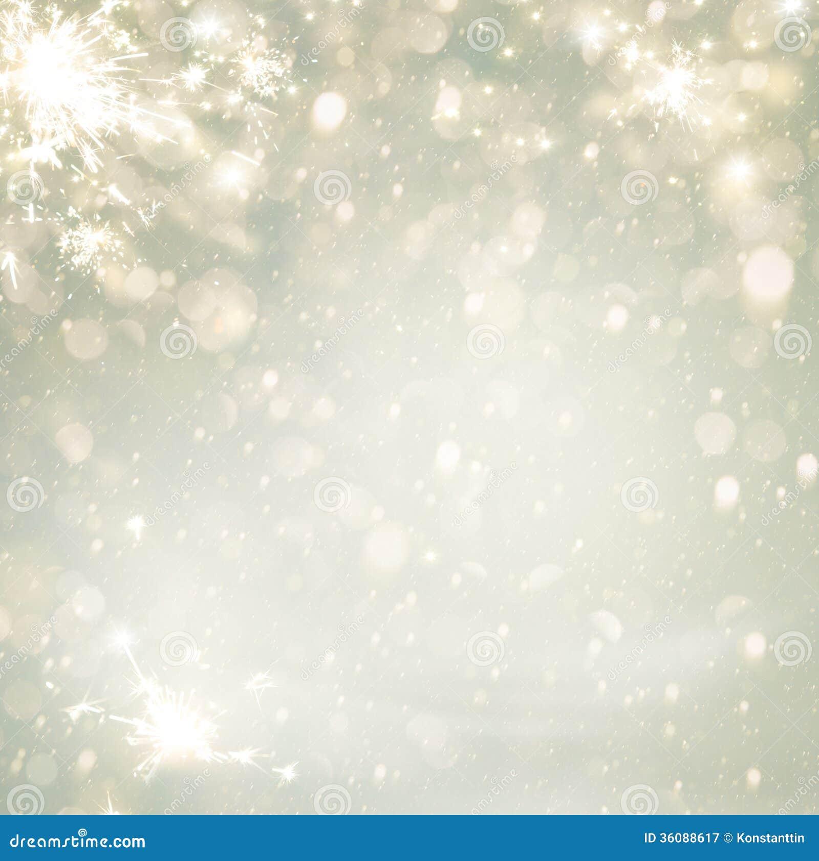 Scintillio dorato del fondo di festa di Natale astratto Defocused